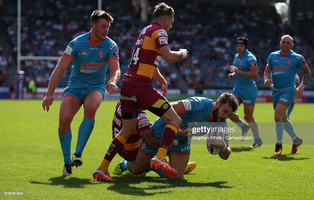St Helens' Alex Walmsley forces his way through and scores his sides seventh try during the First Utility Super League Round 22 match between Huddersfield Giants and St Helens at the John Smith's Stadium on July 17, 2016 in Huddersfield, England.