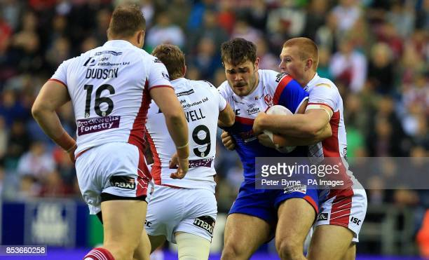St Helens' Alex Walmsley is tackled by Wigan Warriors' Jack Hughes during the First Utility Super League at the DW Stadium Wigan