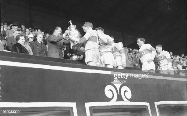 St Helens are presented with the trophy after their 13 2 victory over Halifax in the Rugby League Cup Final at Wembley 28th April 1956