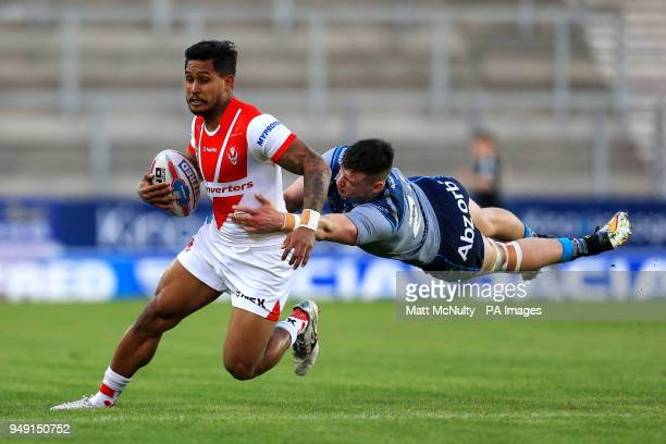 St Helens' Ben Barba takes on Huddersfield Giants' Sam Wood during the Betfred Super League match at the Totally Wicked Stadium St Helens
