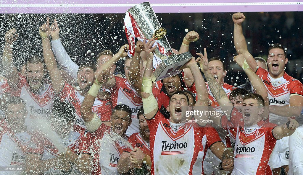 St Helens captain Paul Wellens lifts the trophy after winning the First Utility Super League Grand Final between St Helens and Wigan Warriors at Old Trafford on October 11, 2014 in Manchester, England.