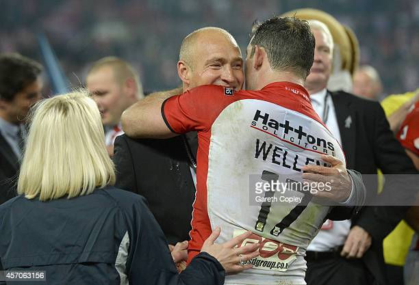 St Helens coach Nathan Brown and captain Paul Wellens embrace after winning the First Utility Super League Grand Final between St Helens and Wigan...