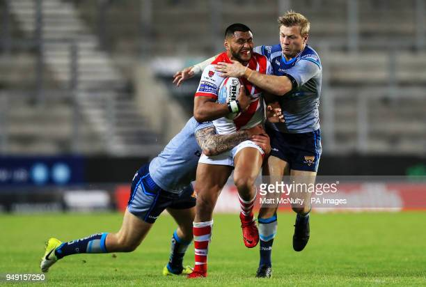 St Helens' Dominique Peyroux is tackled by Huddersfield Giants' Ryan Hinchcliffe during the Betfred Super League match at the Totally Wicked Stadium...