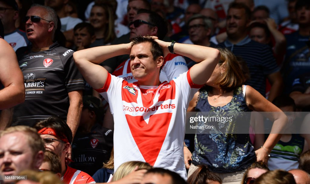 A St Helens fan holds his hands on his head during the Ladbrokes Challenge Cup Semi Final match between St Helens and Catalans Dragons at Macron Stadium on August 5, 2018 in Bolton, England.