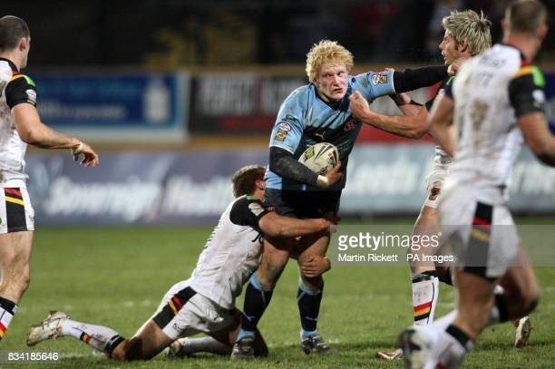 St Helens' James Graham is tackled by Bradford's Glenn Morrison and Wayne Godwin during the engage Super League match at Odsal Stadium Bradford