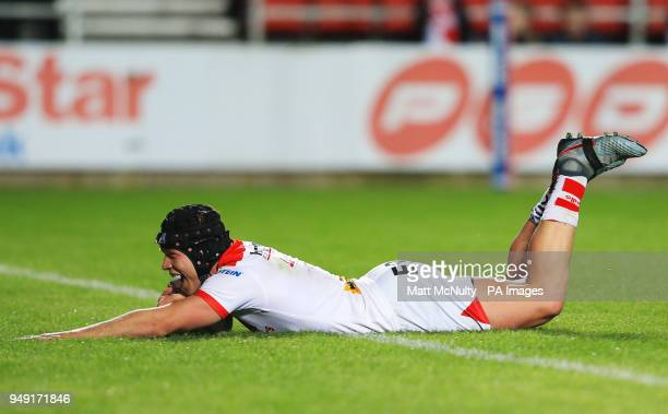 St Helens' Jonny Lomax scores a try during the Betfred Super League match at the Totally Wicked Stadium St Helens