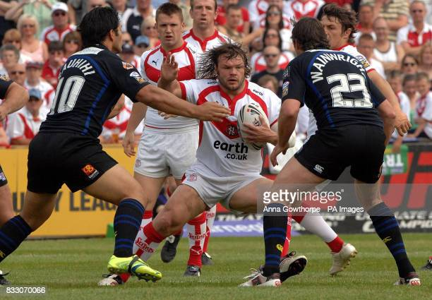 St Helens' Keiron Cunningham up against Warrington's Paul Rauhihi and Mike Wainwright during the Challenge Cup Quarter Final match at Knowsley Road...