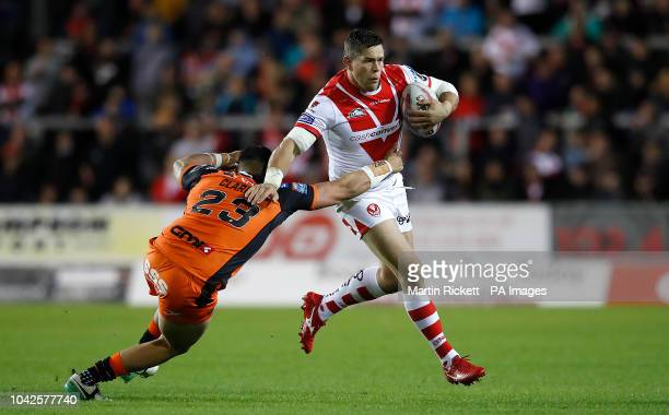 St Helens' Louie McCarthyScarsbrook is tackled by Castleford Tigers Mitch Clarke during the Betfred Super League Super 8's match at The Totally...