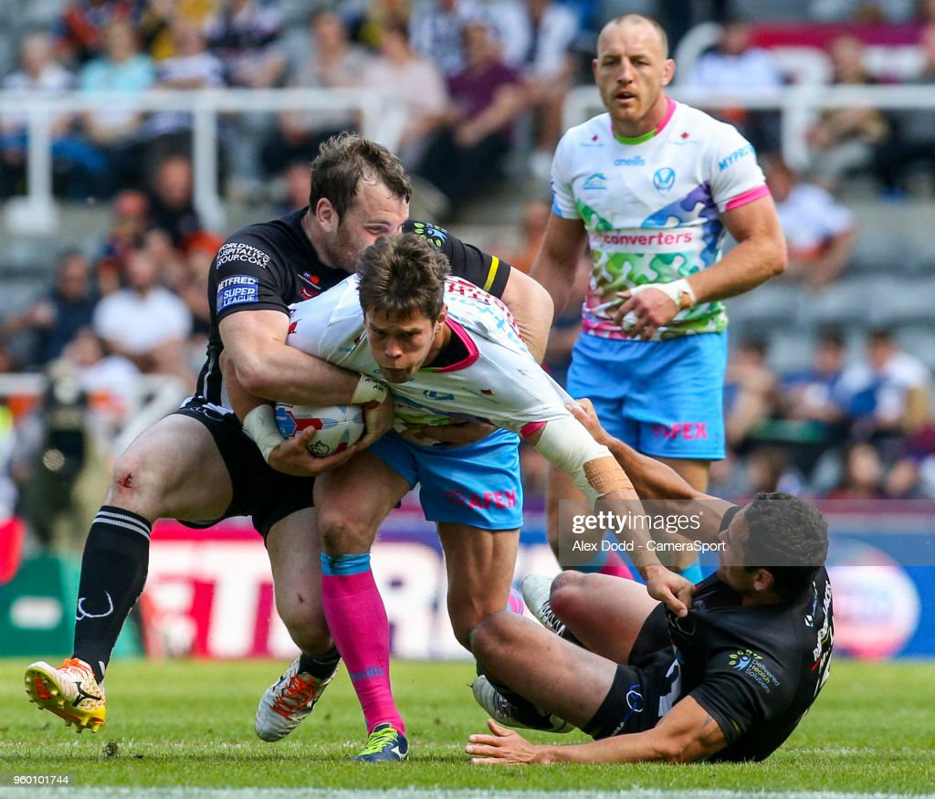 St Helens' Louie McCarthy-Scarsbrook is tackled by Widnes Vikings's Hep Cahill and Greg Burke during the Betfred Super League Round 15 match between Widnes Vikings and St Helens at St James' Park on May 19, 2018 in Newcastle upon Tyne, England.