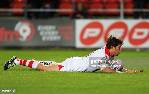 St Helens' Louie McCarthyScarsbrook scores a try during the Betfred Super League match at the Totally Wicked Stadium St Helens