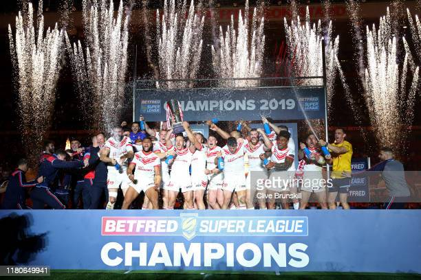 St Helens players celebrate as they lift the trophy after winning the Betfred Super League Grand Final between St Helens and Salford Red Devils at...