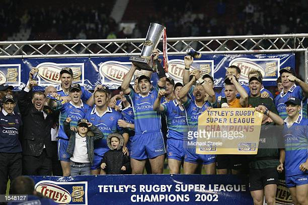 St Helens players celebrate being crowned Superleague champions 2002 after the Super League Grand Final between Bradford Bulls and StHelens held on...