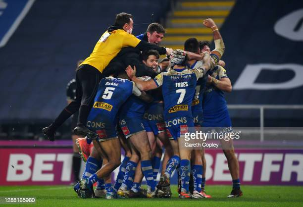 St Helens players celebrate scoring the winning try on the final play during the Betfred Super League Grand Final between Wigan Warriors and St...