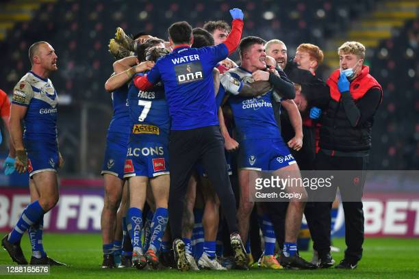 St Helens players celebrate victory on the final play during the Betfred Super League Grand Final between Wigan Warriors and St Helens at KCOM...