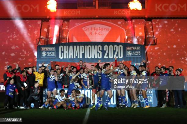 St Helens players celebrate with the trophy following victory during the Betfred Super League Grand Final between Wigan Warriors and St Helens at...