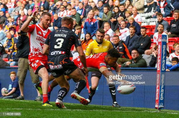 St Helens' Regan Grace scores his side's second try during the Dacia Magic Weekend Round 16 match between St Helens and Castleford Tigers at Anfield...