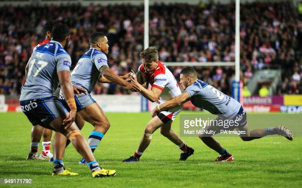 St Helens' Ryan Morgan takes on Huddersfield Giants' Darnell McIntosh during the Betfred Super League match at the Totally Wicked Stadium St Helens