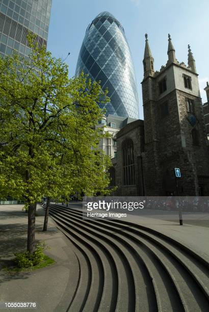 St Helen's Square with the Church of St Andrew Undershaft dating from 1520 in the foreground and the St Mary Axe office building known as the Gherkin...