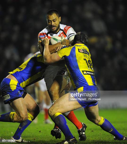 St Helens Tony Puletua is tackled by Warrington Wolves' Mike Cooper and Chris Hill during the Super League match at Halliwell Jones Stadium Warrington
