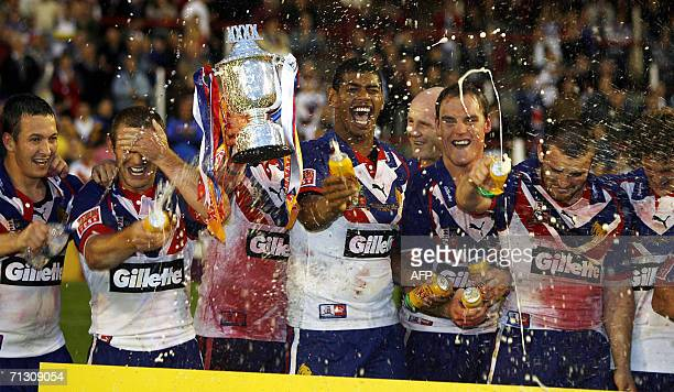 Britain's players celebrate after defeating New Zealand during the XXXX Rugby League test at Knowsley Road in St Helens 27 June 2006 AFP PHOTO/ANDREW...