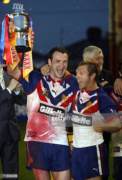 Britain's players Jamie Peacock and Sean Long celebrate with the trophy after defeating New Zealand during the XXXX Rugby League test at Knowsley...