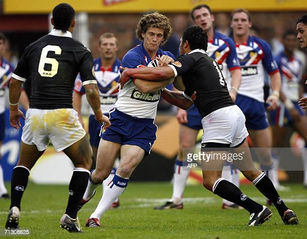 Britain's Sean O'Loughlin runs the ball out of the defence during a XXXX Rugby League test against New Zealand at Knowsley Road in St Helens 27 June...