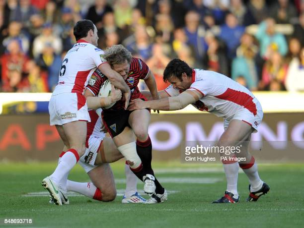 St Helens's Lance Hohaia and Jon Wilkin tackle Warrington Wolves's Ben Westwood during the Stobart Super League Semi Final Langtree Park St Helens