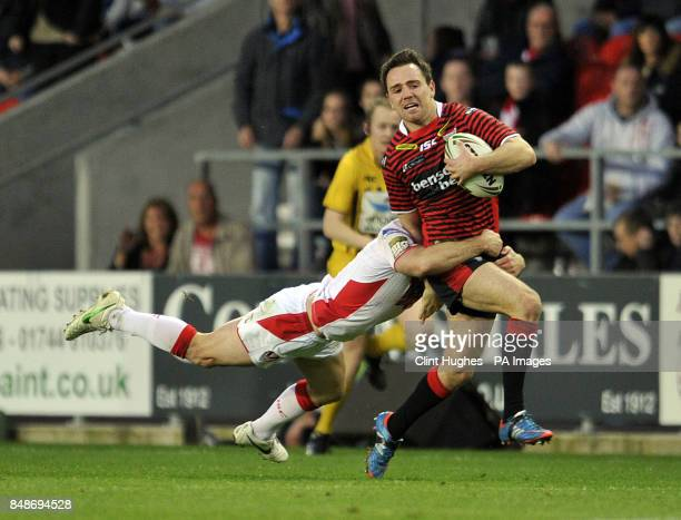 St Helens's Lance Hohaia tackles Warrington Wolves's Richie Myler during the Stobart Super League Semi Final Langtree Park St Helens