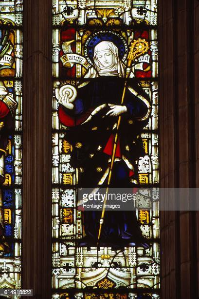St Hilda of Whitby holding an ammonite West window Hereford Cathedral 20th century Medieval stained glass window in Hereford Cathedral depicts Hilda...