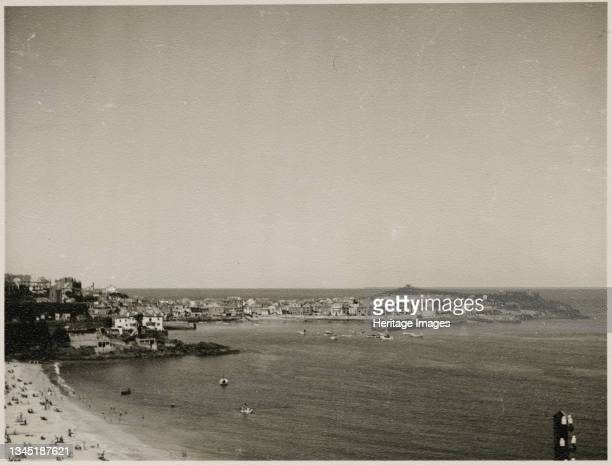 St Ives, Cornwall, 1953. A view of St Ives and St Ives Harbour from Porthminster Point, with Porthminster Beach in the foreground. Artist JR...