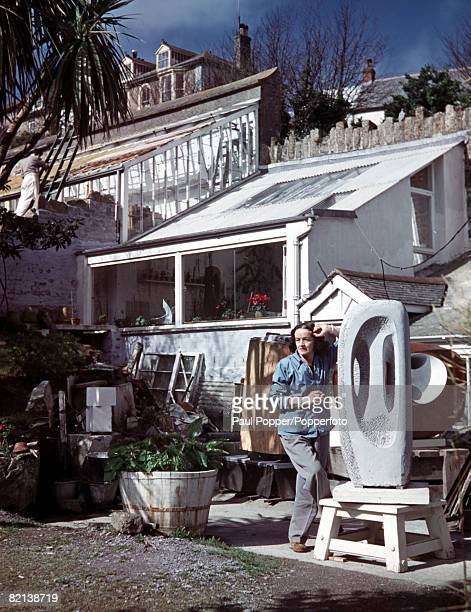 St Ives Cornwall England May 1957 English sculptor Barbara Hepworth is pictured with some of her completed works