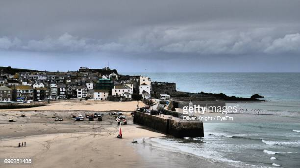 st ives town by sea against cloudy sky - st ives stock pictures, royalty-free photos & images