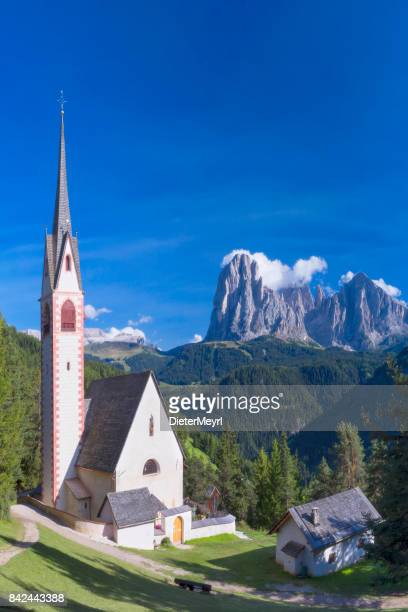 st jacob church above val gardena in dolomites, south tyrol - central europe stock photos and pictures
