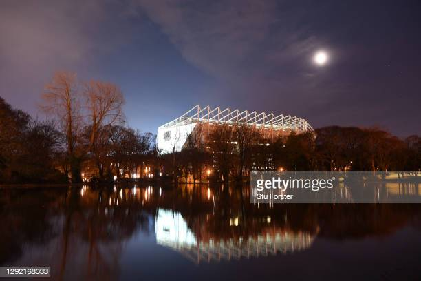St James' Park seen reflected in Leazes Park lake before the Premier League match between Newcastle United and Fulham at St. James Park on December...