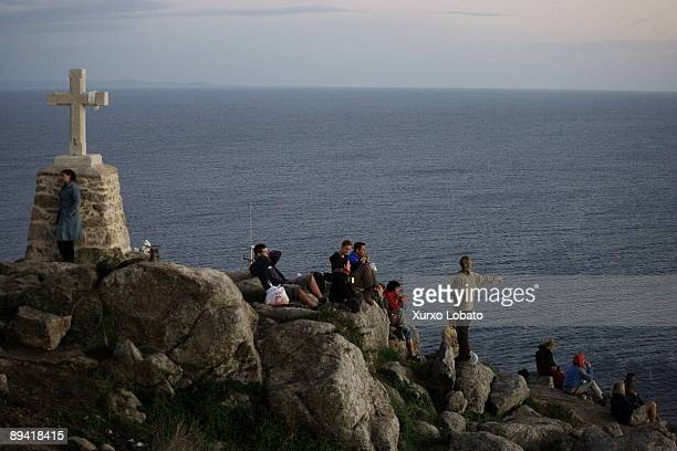 St Jame´s way Pilgrims looking at sunset in Finisterre cap end of St James way