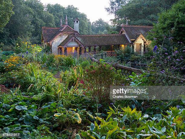 St. Jamess Park lake with Swiss Chalet (Duck Island Cottage), London, England, United Kingdom, Europe