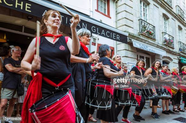 st jean de luz, female troupe of traditional basque drummers celebrating bastille day - bastille band stock pictures, royalty-free photos & images