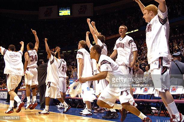 St Joe's bench jumps to their feet after defeating Wake Forest 8480 at the Continental Airlines Arena in East Rutherford New Jersey March 25 2004