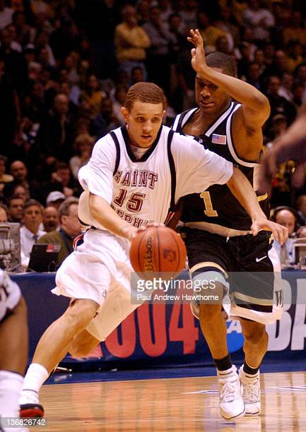 St Joe's Delonte West drives the lane against Wake Forest defender Justin Gray during second half action at the Continental Airlines Arena in East...