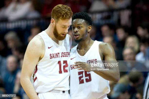 St Joe's Forward James Demery talks strategy with Forward Anthony Longpré in the first half during the game between the St Joe's Hawks and Villanova...