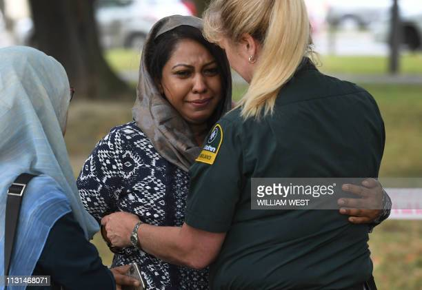 A St John Ambulance member speaks to a mourner outside the Masjid Al Noor mosqu in Christchurch on March 19 where worshippers were gunned down four...