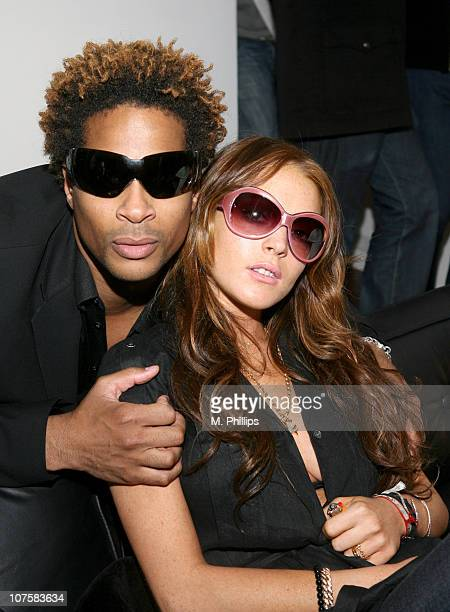 St. John and Lindsay Lohan during GQ / Calvin Klein Celebrity Poker Tournament Benefiting Peace Games - Calvin Klein Gift Lounge at Private Residence...