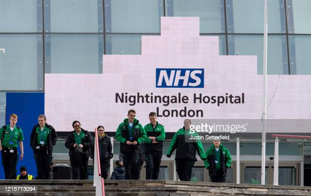 St Johns Ambulance staff leave the NHS Nightingale hospital at the Excel on March 30 2020 in London England The field hospital will initially contain...