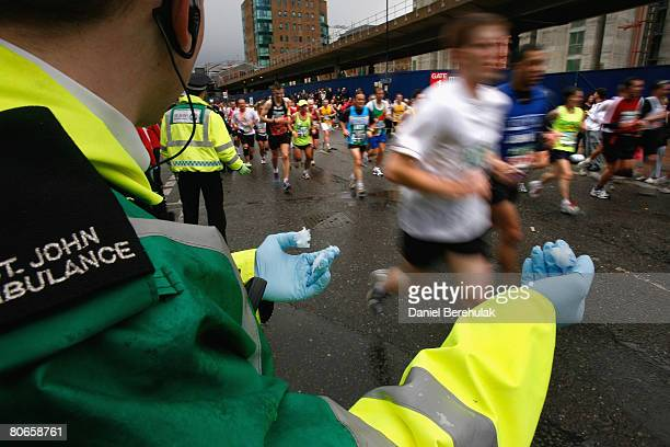 St John's Ambulance worker holds out vaseline for runners during the 2008 Flora London Marathon on April 13 2008 in London England