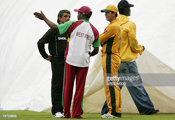 St John's ANTIGUA AND BARBUDA Australia's captain Ricky Ponting listens to West Indies captain Brian Lara and umpire Asad Rauf during a rain delay in...