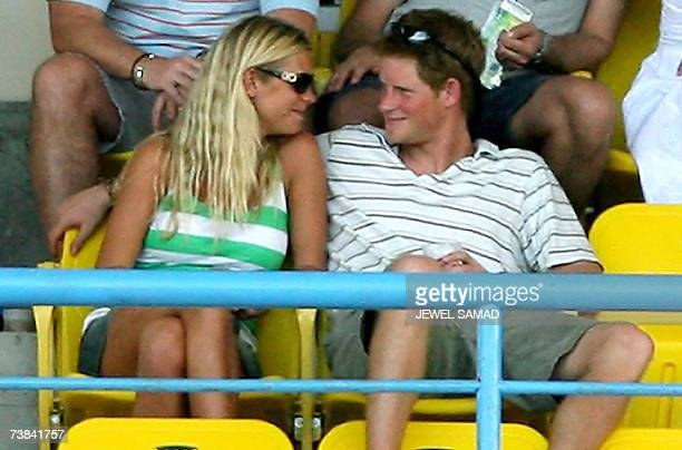 St John's ANTIGUA AND BARBUDA Britain's Prince Harry admires his girlfriend Chelsy Davy as they watch the ICC World Cup Cricket 2007 Super Eight...