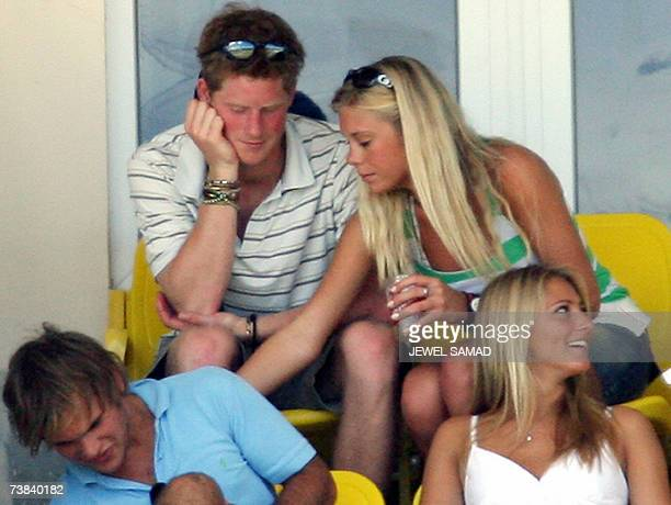 St John's ANTIGUA AND BARBUDA Britain's Prince Harry and his girlfriend Chelsy Davy share a private moment as they watch the ICC World Cup Cricket...