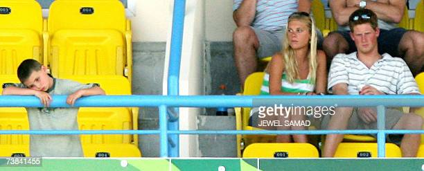 St John's ANTIGUA AND BARBUDA Britain's Prince Harry and his girlfriend Chelsy Davy watch the ICC World Cup Cricket 2007 Super Eight match between...