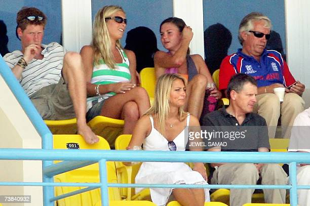St John's ANTIGUA AND BARBUDA Britain's Prince Harry sits next to his girlfriend Chelsy Davy as he watches the ICC World Cup Cricket 2007 Super Eight...