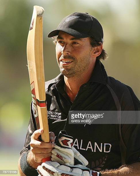 St John's ANTIGUA AND BARBUDA Captain Stephen Fleming of New Zealand raises his bat towards fans as he leaves the field after his team's victory...